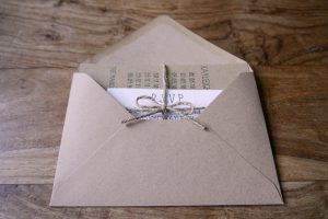 Handmade invitation with gift list, RSVP and tied with twine.