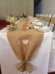 Their hessian table runner was personalised with their initials.