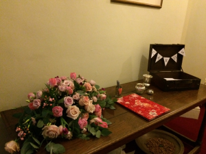 Flower arrangement by Sherwood Florist. Suitcase sourced and bunting hand made By Eleanor Gail.